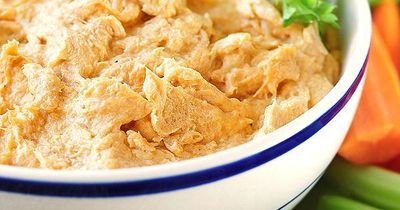This easy Buffalo Chicken Dip is a party favorite. It can be made ahead and prepared stovetop, in the oven, or slow cooker.