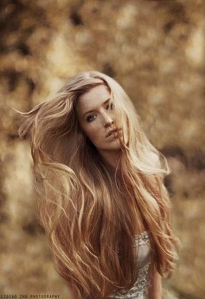 Girl with long, flowing blonde hair I'd love to have my hair this long.