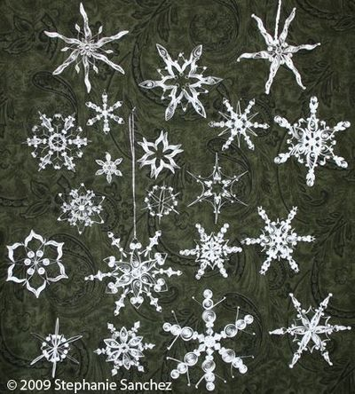 Paper filigree snowflakes. Interesting. I used to make all my Christmas money making and selling these. I'd never seen anybody else do quilled snowflakes. Love the Internet.