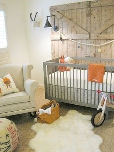 "Also serves as inspiration for my own bedroom. ""Bold Barn doors used as wall art sets the tone for this nursery. Muted tone colours, wooden toys and the sheep skin on the floor gives this nursery a cozy and rustic feel."". I love this because it&..."
