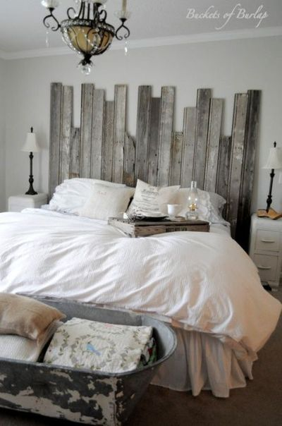 Rustic Romantic Master Bedroom, With soft gray walls and a DIY recycled headboard, this master bedroom has a rustic, yet romantic feel., rustic headboard made with recycled barn wood and cowboy tub at the end of bed , Bedrooms Design