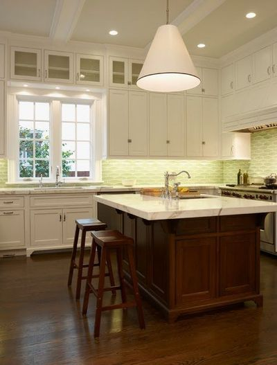 One of the inspiration photos I used when planning my own kitchen. Love the white to-the-ceiling cabinets contrasted by the dark wood island and floors and the glass tile backsplash. Perfection.