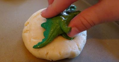 dino fossil cookies. Great Idea, you can do this with any toy.
