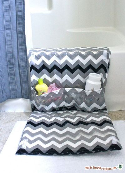 Give your knees a break with the Rub-A-Dub Tubside Mat! It makes bathtime a breeze, with a comfy cushion and a pocket that gives you easy access to your tot's toiletries. Velcro tabs allow it to fold up when not in use, while suction cups keep it pl...