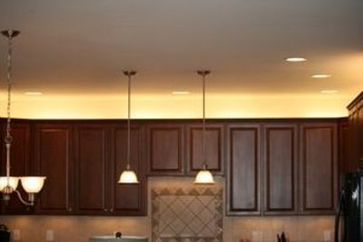 Our company president added over cabinet lighting to his for Over the counter lighting