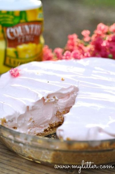 Awesome, summer Pink Lemonade Pie recipe. Completely refreshing and wonderful to serve to a crowd! Use any flavor juice, our favorite is lemonade!