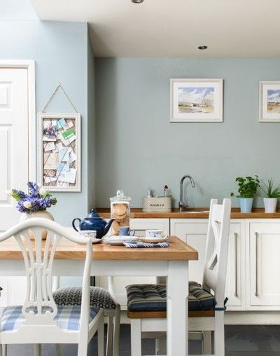 Need country kitchen decorating ideas? Take a look at this country-style kitchen with duck egg blue walls and white cabinets. Find more kitchen decorating ideas at theroomedit.com