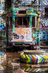 abandoned train covered in graffiti