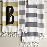 These are great, simple, come in a variety of colors and you can add a monogram if you're feeling fancy! perfect for a guest bath that will use mainly hand towels