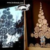 Cut out some snowflakes, and arrange them into the shape of a tree, in your window.. Very pretty!