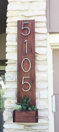 Built by Broads and Boards This simple DIY project is a quick way to add curb appeal to your home. Made from an inexpensive cedar fence picket and house numbers
