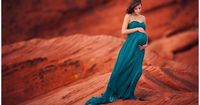 POSE gorgeous soft hands. Lisa Holloway of LJHolloway Photography photographs gorgeous pregnant woman in the Valley of Fire on the red rocks wearing long teal gown