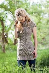 Smooth, drapey alpaca streamlines the look of a cabled tunic. A slim fit and kangaroo pocket keep chunky cables modern. Piece is knit flat and seamed.