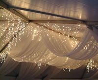 Lighted tent draping.
