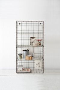 Wire Wall Rack - I have some wire racks similar to that. Totally need to try to make shelves out of it. Now if only I remember where I put it. LoL