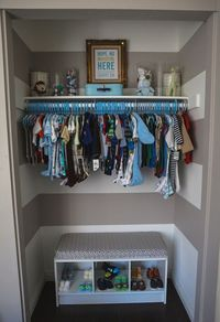Cute stripes in the closet! Love the little shoe bench.