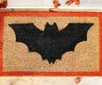 Decorate your doorstep to welcome trick-or-treaters for Halloween with this easy-to-make bat-theme doormat.