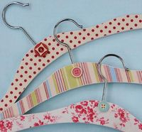 I used vintage fabric inspired scrapbook paper from Making Memories to decoupage child size wooden hangers.