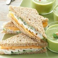 """These dainty finger sandwiches are perfect for casual picnics or luncheons. Tarragon-seasoned chicken complements cucumber and cantaloupe slices. �€""""Taste of Home"""