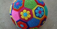 This is for all my crochet friends - awesome!! Ravelry: African Flower Soccer Balll pattern by Leslie Stahlhut