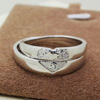 http://www.gullei.com/engraved-heart-shaped-wedding-rings-for-women-and-men.html