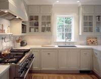 Moroso Construction: Beautiful U shaped kitchen with light gray kitchen cabinets, marble countertops, marble ...
