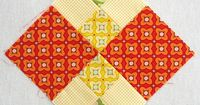 I love this block. . . maybe it's just the color scheme, but I double heart it!