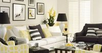 Go for a smart, tailored look in the living room, mixing black and white with accents of fresh yellow to lighten the look.