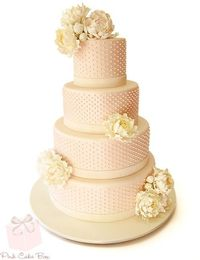 Using inspiration from a photo sent by the bride, we worked with the bride to help design this blush pink four tier wedding cake for a wedding this past weekend