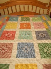 This would make a nice mini quilt with tiny squares of embroidery.