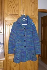debbie4234's Caribbean Wave Hooded Coat Car Coat pattern by Ann E Smith This is a really pretty coat but I can't find any really good photos of it.