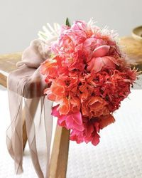 When it comes to choosing the blooms you'll carry down the aisle, why go the expected route? Personalize your flowers with fresh trimmings and your favorite col