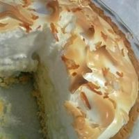 Old Fashioned Coconut Cream Pie | Sweetened toasted coconut is stirred into a homemade custard filling and poured into a pie shell. After the pie is chilled and set, it's covered with whipped topping and more toasted coconut.