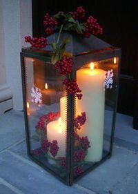 Creating a Christmas Lantern. Add a few Christmas-inspired flourishes to a hurricane lantern to create a beautiful holiday decoration.
