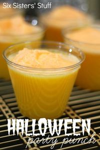 Halloween Orange Party Punch from SixSistersStuff.com. Perfect for Halloween parties! Your guests will love it! #recipes #halloween #party #punch