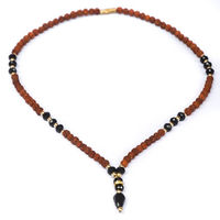 5mm rudraksha seed bead necklace accented with faceted glass beads $8.0