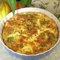 Basic Quiche: Reduced to 1 1/2 cup regular milk, used COOKED potatoes, mushrooms, and onions and raw green bell pepper. Made olive oil crust.