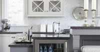 Love the how the wine cooler and small bar have been incorporated into and are part of this kitchen's island.