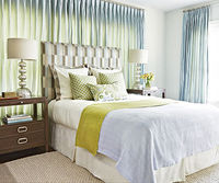 A bed that peeks over a window frame looks odd from the street and can lead to uneven fading. However, what if it's the only place for your bed? Make it look better with these tricks: Hang floor-length curtain panels that fall behind the headboard a...