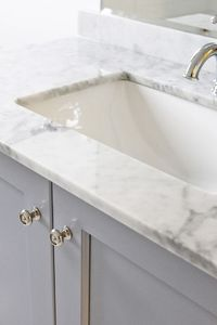 Benjamin Moore pigeon gray cabinets & marble counter tops. Guest bath