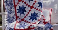Oh My Stars quilt combines two blocks LeMoyne Star and Irish Chain pattern at allpeoplequilt.com