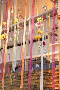 Wedding curtain made up of ribbons, flowers and ornaments. #Reception #Decor #Ribbons #Celebstylewed.