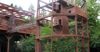 Awesome outdoor cat house. We've talked about building one for the cats who are too crazy to live indoors.