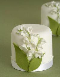 lilies of the valley on bite size wedding guest take home cake.