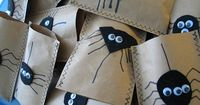 DIY Halloween Treat Bags made with grocery bags, left over felt and jiggle eyes. Really cute, love that each one is different.