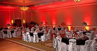 Love the Orange Uplighting - & The chairs match our theme too - Google Image Result for http://www.84weststudios.com/images/lighting/up-lighting-red-wedding.jpg