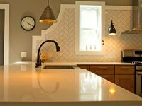 The kitchen decorating experts at HGTV.com share 30 creative kitchen backsplashes using the trendiest materials: ceramic tile, glass, mosaics, natural stone and