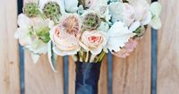 billy button, blushing bride, rose, dusty miller, and scabiosa pods. Green & Peach
