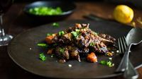 Melissa Clark braises oxtail with red wine, carrots and celery root for flavorful, fork-tender meat.