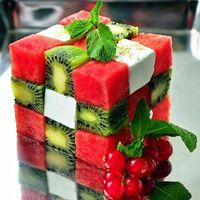 Materials: Tooth Picks Square fondant cutters Ingredients 1 pound of watermelon 2 kiwi Small block of feta cheese Spearmint Sprigs Method Cube the fruit and cheese Alternate the fruit and cheese pieces I broke off toothpicks and placed them down the cente...